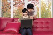 Couple Choosing Something On Laptop