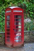 Little Girl In A Telephone Booth