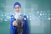 Muslim Businesswoman Using Modern Interface