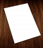 White blank A4 flyer on wood