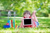 Happy School Boy With A Tablet Pc