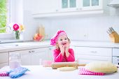 Cute Little Girl Baking A Pie