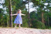 Little Girl Running On Sand Dunes