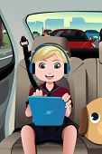foto of car ride  - A vector illustration of little boy riding a car using a tablet - JPG