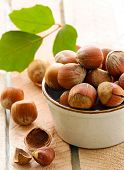 natural organic hazelnuts in a bowl on the table