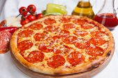 stock photo of italian food  - Pizza on wood - JPG