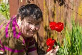 Disabled Woman Smells On A Flower