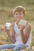 Teenage Farmer Boy Holding Milk And Bread