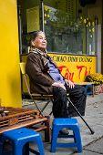 Elderly Vietnamese Woman Sitting In The Street