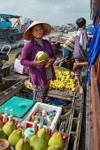Women Selling Goods From A Boat On The Mekong River, Vietnam