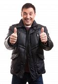 picture of down jacket  - Handsome man in a down jacket showing his thumbs up - JPG