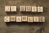 I am Charlie (In French) on wooden cubes on a wooden background