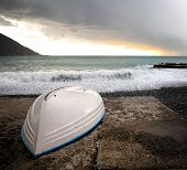 Boat Hull Waiting For The Summer Against Stormy Seascape