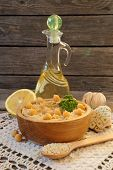 Hummus In A Wooden Bowl And Ingredients To Cook It