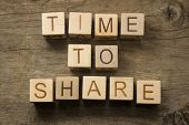 Time to Share text on a wooden background