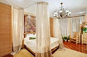 Medieval style bedroom with canopy bed on wide angle view poster