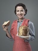 Woman In Apron Eating Panettone