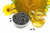Sunflower Oil, Sunflower Seeds, And Flowers On A White Background.