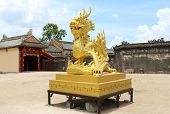 pic of emperor  - Golden stone dragon statue in Vietnam  - JPG