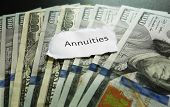 stock photo of cash  - Annuity note on top of assorted cash - JPG