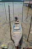 Wooden boat at low tide in the floating village of sea gypsies in the Andaman Sea