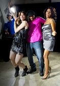 pic of swingers  - charming single man with two women at a nightclub - JPG