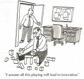 image of moaning  - Cartoon of business man sitting on floor with array of blocks - JPG