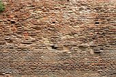 Weathered and old red brick wall