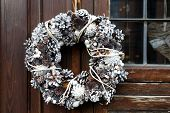 Wreath Of Cones On Old Wooden Wall