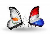 Two Butterflies With Flags On Wings As Symbol Of Relations Cyprus And Luxembourg