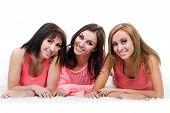 Three beautiful young women posing