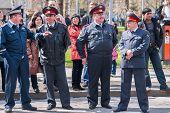 Four policemen stand in cordon