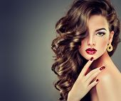 stock photo of brunette hair  - Beautiful model brunette with long curled hair and fashion makeup - JPG