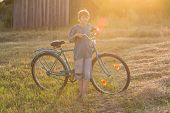 Smiling Teenager Boy Standing With Bicycle