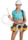 stock photo of coil  - Woman wearing hard hat and tool belt - JPG