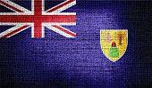 Turks and Caicos Islands flag on burlap fabric