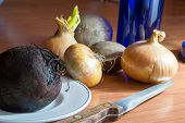 Beetroot onions Potatoes blue wine bottle and a knife