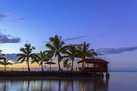 picture of samoa  - Palm trees and beach hut at sunset on Samoa - JPG
