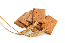 foto of whole-grain  - Stack of cracker slices for balance diet and wheat on white background - JPG