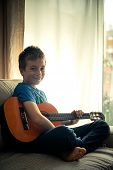 pic of little boys only  - Portrait of a cute little boy posing with guitar - JPG