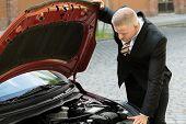 pic of breakdown  - Young Man Looking Under The Hood Of Breakdown Car - JPG