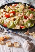 pic of caesar salad  - Delicious Caesar salad with shrimp and tomatoes close - JPG