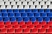 image of grandstand  - Empty grandstand with Seating in the colors of the Russian flag - JPG