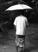A Man Uner The Umbrella During The Rain