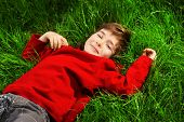stock photo of 7-year-old  - Cute 7 years old boy having fun outdoor - JPG