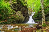 stock photo of waterfalls  - Beautiful small waterfall In Balkan Mountains Bulgaria - JPG