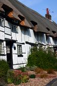 A Row Of Whitewashed Thatched Cottages