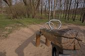 picture of seesaw  - An empty silver seesaw on a playground - JPG