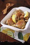 stock photo of pot roast  - Roast chicken legs with lemon and lemon zest - JPG