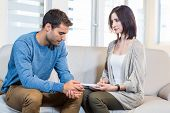 image of psychologist  - Psychologist talking with depressed man in the office - JPG